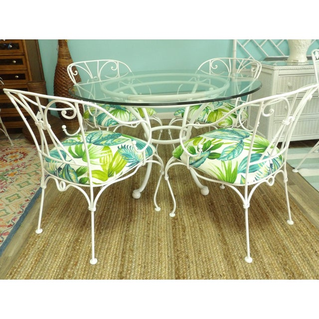 Classic Vintage Woodard Patio Dining Set. The Chairs have typical Woodard graceful lines, shape and design. The set has...