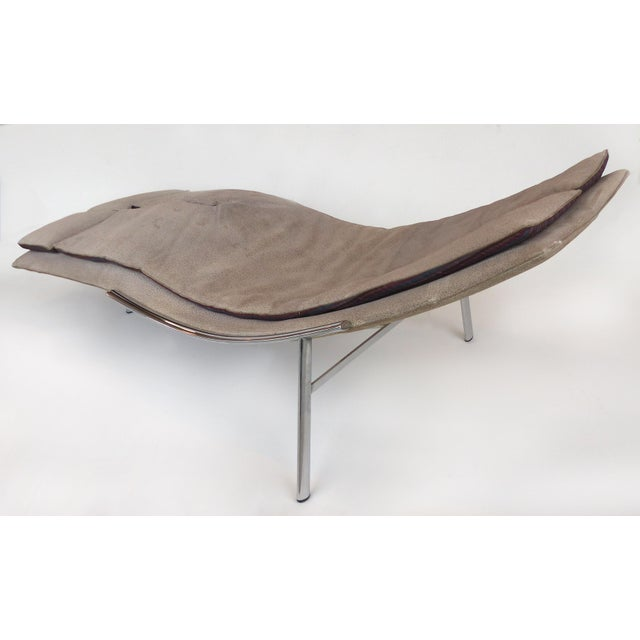 Offered for sale is a chaise lounge by Saporiti Italia upholstered in suede and supported by stainless steel legs. This...