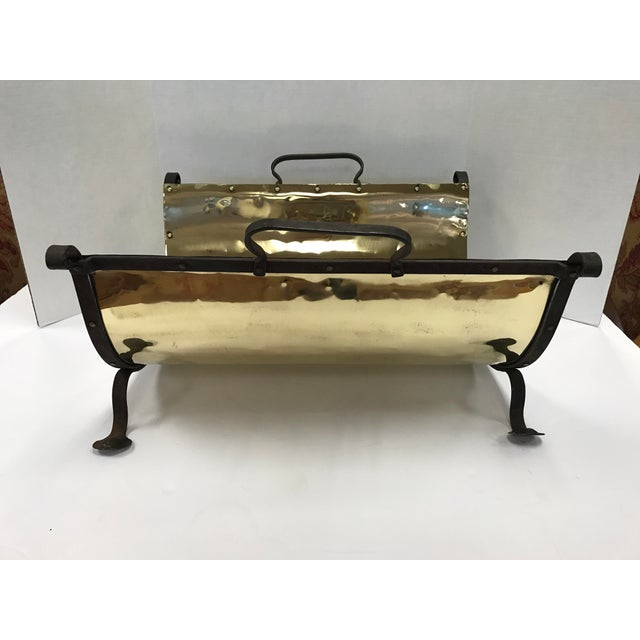 Antique brass firewood holder with a cast iron frame and handles has recently been polished and looks brand new though...