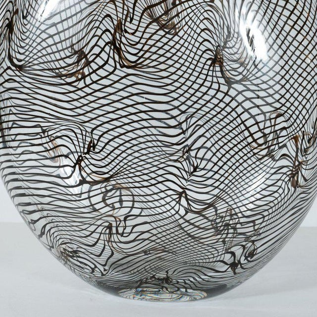 This stunning vase was hand blown in Murano, Italy- the island off the coast of Venice renowned for centuries for its...