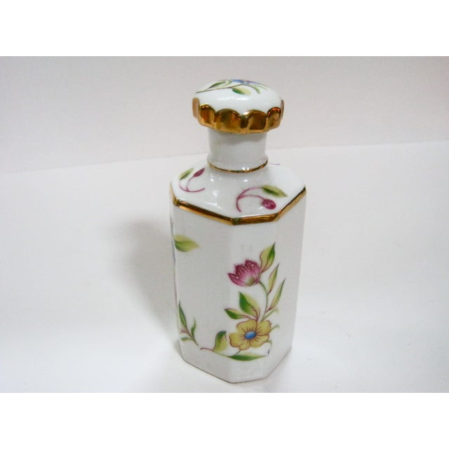 """Cheerfully hand painted perfume bottle with colorful flowers and bright gold trim accents. Stopper/ applier is 3.75""""L...."""