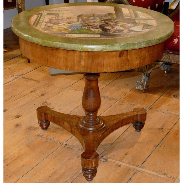 This listing is for an early 19th century Italian fruitwood gueridon or center table with magnificent scagliola top....