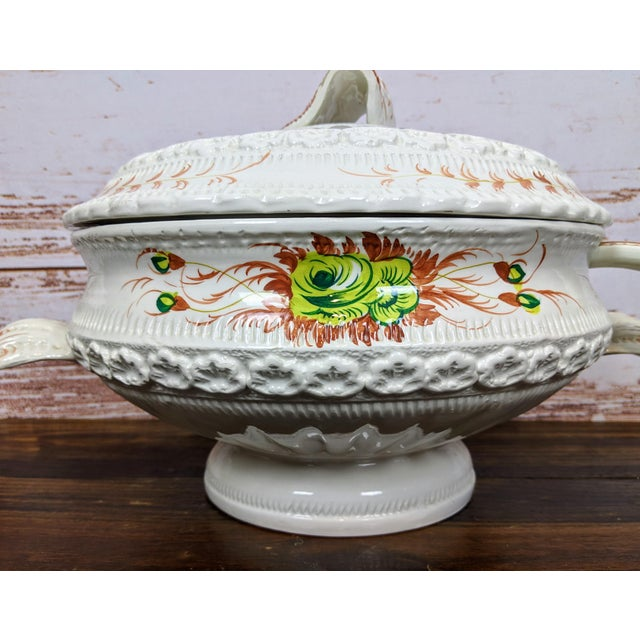 Beautifully made large Italian soup tureen with spoon. Lots of detail and hand-painted with a flower design. In excellent...
