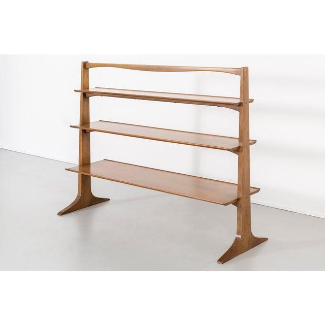 """bookcase designed by Edward Wormley for Drexel USA, c 1950s walnut 41 ⅞"""" h x 54 ⅜"""" w x 18 ¾"""" d shelf depth: top: 8 ¼"""",..."""