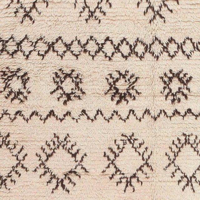 Beautifully decorated with a formal repeating pattern, this magnificent vintage Moroccan rug is a luxurious representation...