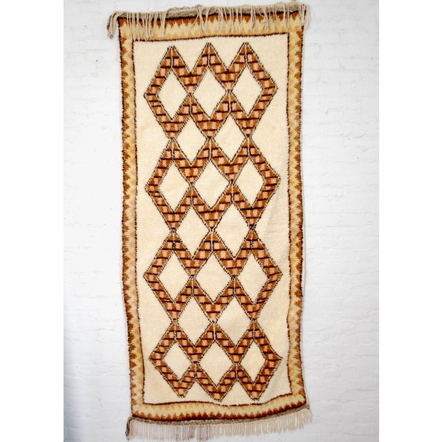 Perfect for apartments and small spaces, this vintage Berber carpet comes from Azilal tribe in the Atlas Mountains of...