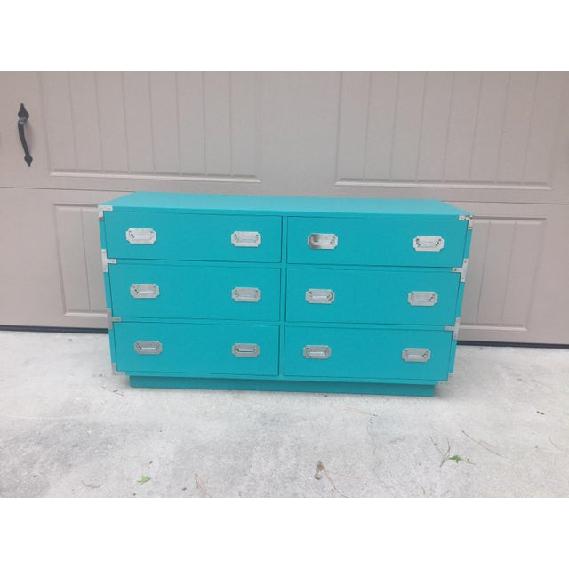 I love this dresser. Finished in a bright turquoise cabinet paint this vintage Dixie Campaign design is brought right into...