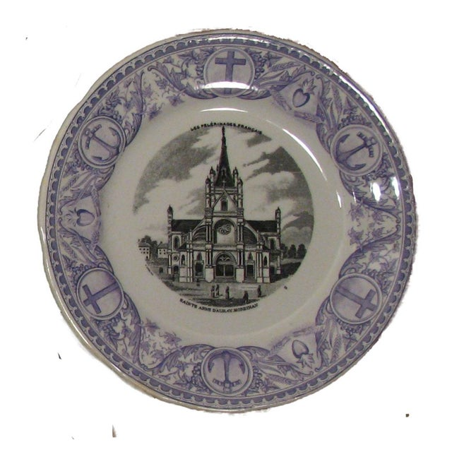 A lovely set of four purple / mulberry / lavender transferware plates highlighting religious pilgrimmage sites in France....