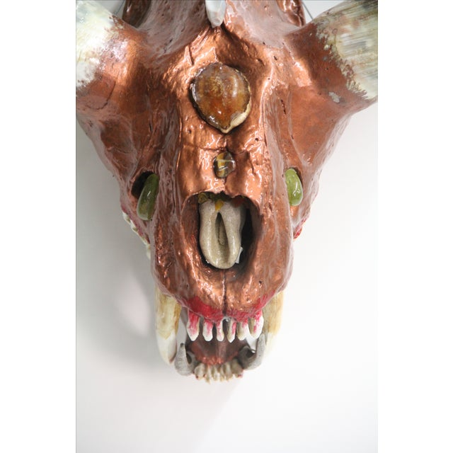 By combining real horns with a Sabretooth tiger skull, we created a now extinct animal that never existed. As such, it is...