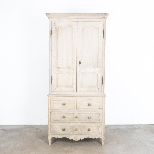 From France, circa 1860, a tall buffet cabinet with drawer chest base. A simple geometric shape recalls a countryside...