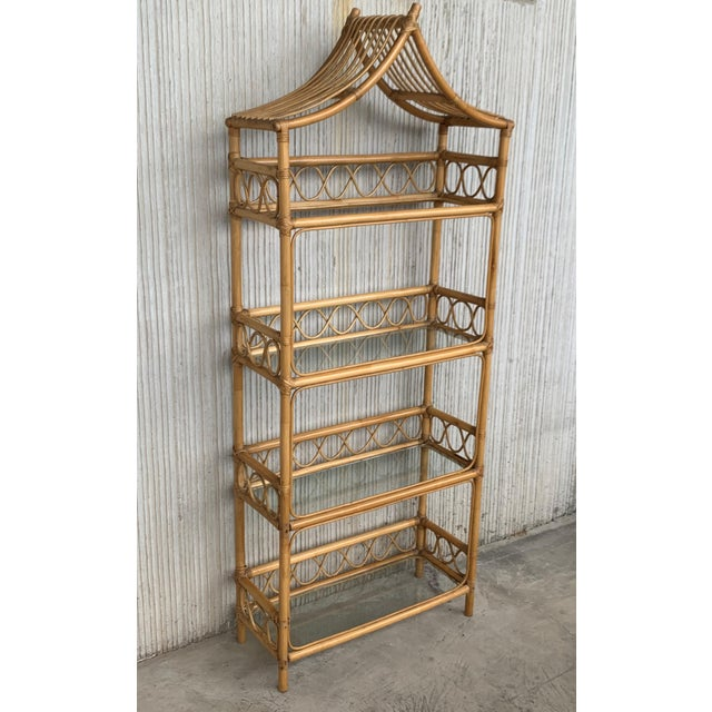 About Midcentury bamboo and glass bookcase étagères, in the Pagoda style. Handsome bamboo with four glass shelves, French,...