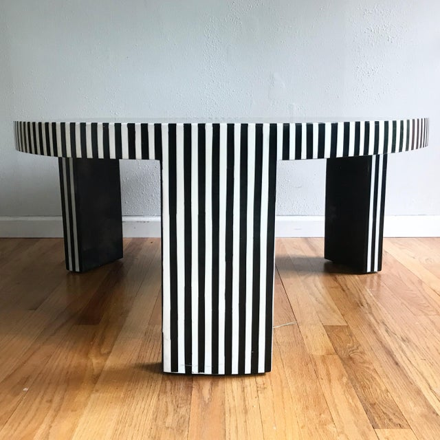 Absolutely hypnotic tessellated white and black resin optic art pattern coffee table by well the well respected Made Goods...