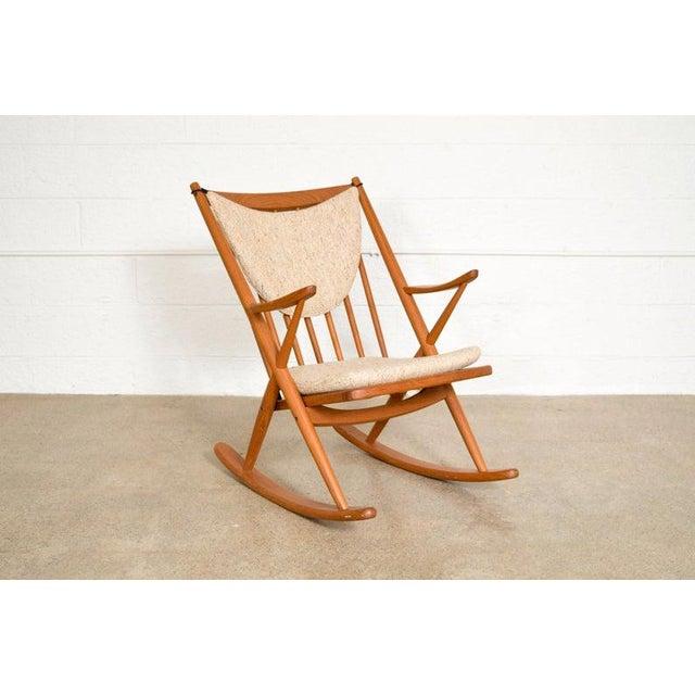 • Vintage mid century modern Frank Reenskaug for Bramin teak rocking chair made in Denmark circa 1960. • Well-constructed...