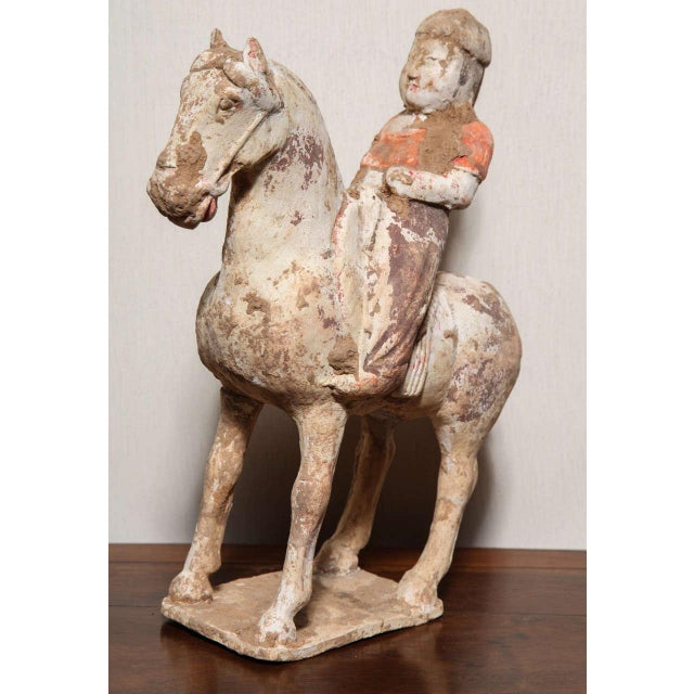 A 7th or 8th century Tang dynasty horse and rider terracotta sculpture. This horse and rider statuette was made in...