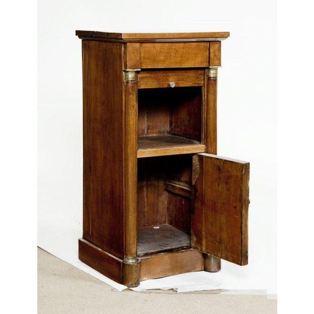 Small early 19th century Italian walnut cabinet with hidden frieze drawer, tambour door opening to a shelf and door...