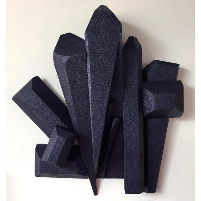 """Dark Crystals"" is a dark purple wall sculpture made out of solid wood and then painted and sealed with a UV semi gloss..."