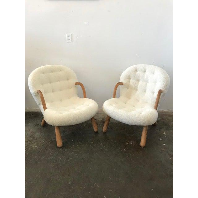 """Pair of Philip Arctander Style """"Clam"""" Chairs,In a luxurious pale boucle fabric..Extremley heavy frames solid oak legs and..."""