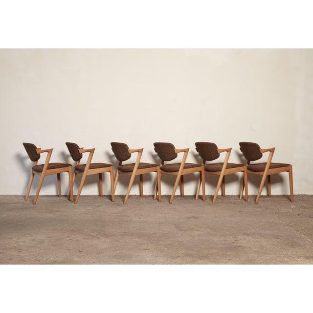 A set of six Model 42 oak dining chairs by Kai Kristiansen for Schou Andersen, Denmark. Tilting backrest. Original fabric...