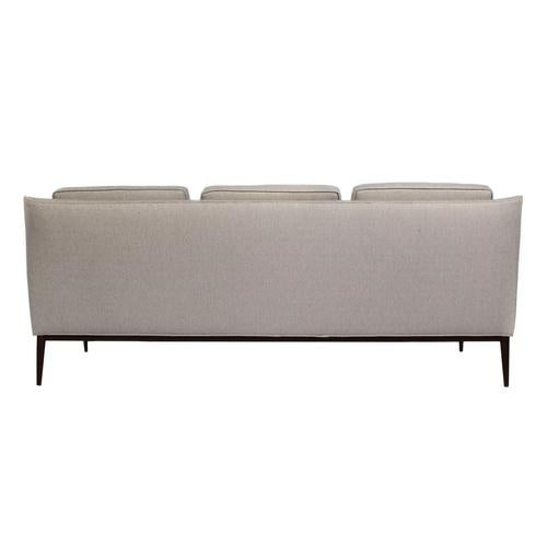 Curved-back, chic three-seat 1950s Paul McCobb sofa floating on tapered and angled walnut legs. Newly restored and...