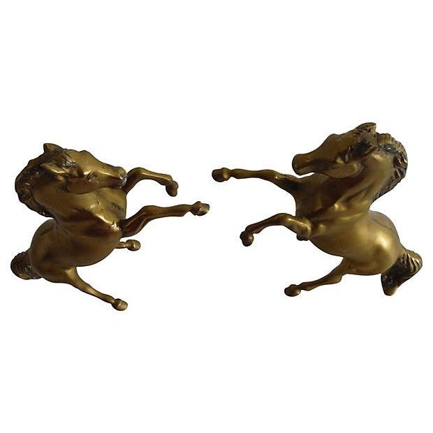 A pair of vintage brass English rearing stallions. Light wear.