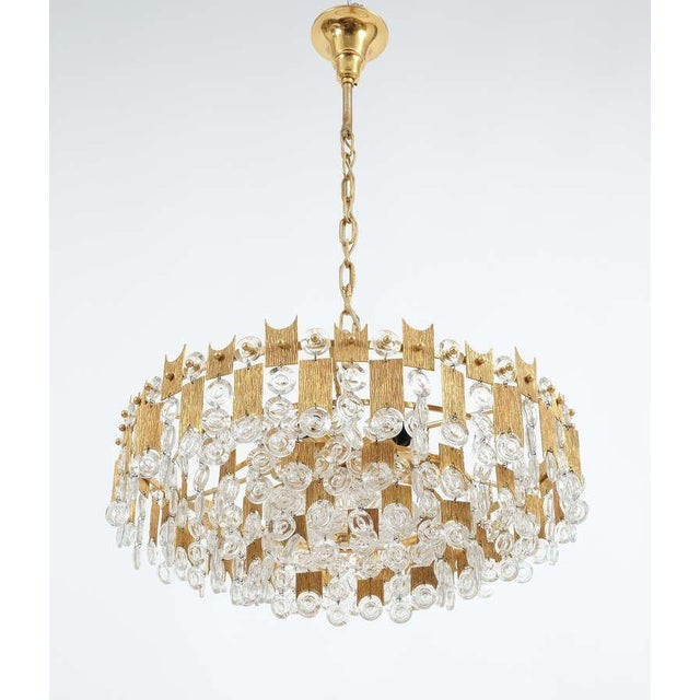 Delicate Palwa chandelier composed of jewel-like glass pieces and grained brass plates in excellent condition. The...