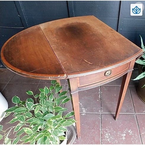 Sweet drop down side table from the 1940's or 1950's. Made of Mahogany wood. Has a small drawer, perfect for light storage!