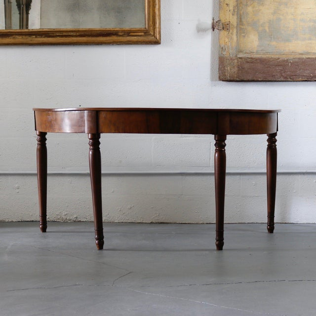 Bold 19th Century Italian demilune consoles. Classic style tapered legs. Beautifully grained wood. A very handsome pair.