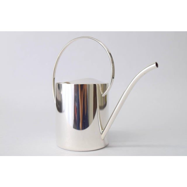 """Stunning diminutive creamer executed in silver plate. Stamped """"Silver Plate Denmark"""" at base of curved handle. Light and..."""