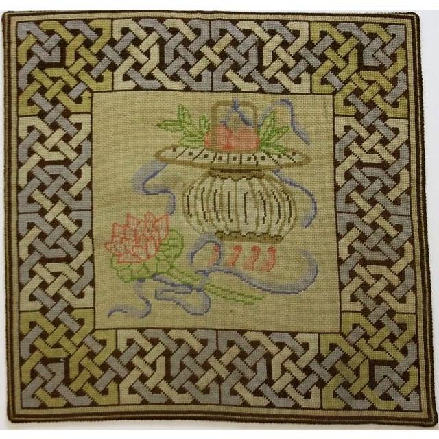 A vintage beige & pastel blue needlepoint floor mat.