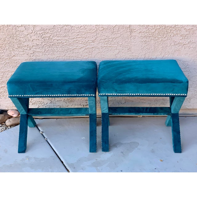 "Gorgeous Billy Baldwin style X-benches upholstered in teal velvet and trimmed in chrome nailheads. Each measures 21""w x..."
