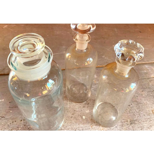American Set of 3 Old Glass Pharmacy Bottles With Stoppers For Sale - Image 3 of 7