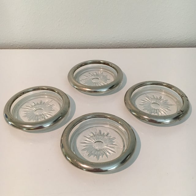 A set of four vintage Leonard silver plate coasters. Made in Italy.