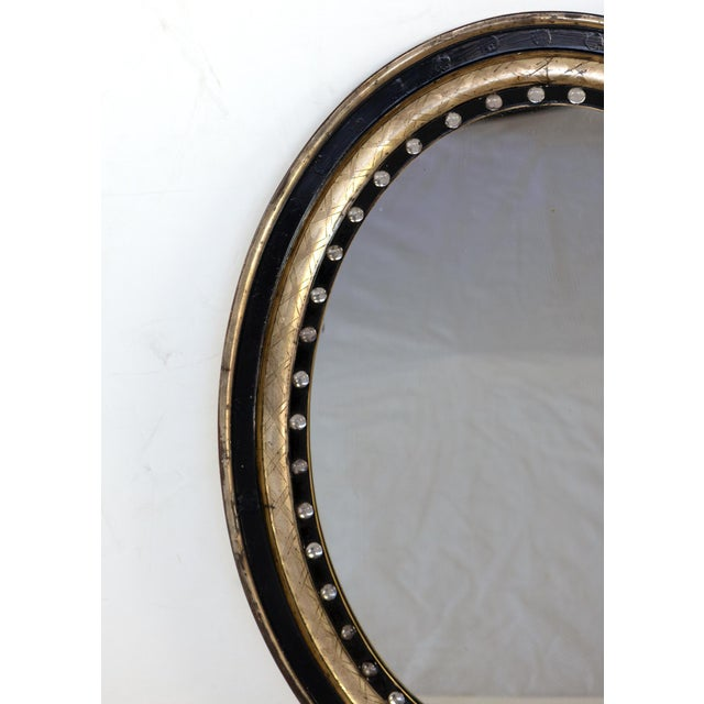 English Irish Oval Mirror With Moulded Parcel-Gilded and Ebonized Frame, Applied With Mirrored Glass Facets, Circa 1890 For Sale - Image 3 of 6