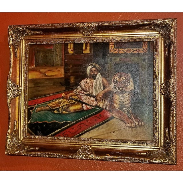 Nice 19th Century Oil on Canvas depicting a Raj or Indian Prince relaxing with his Bengali Tiger on his palatial rug...