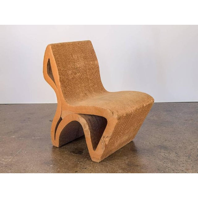 Unique, one-off vintage corrugated cardboard chair. Reminiscent of Frank Gehry's cardboard Wiggle chair, this minimal...