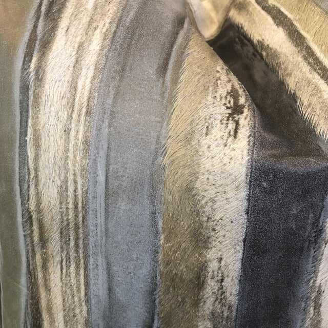 """Custom pair of 22"""" pillows covered in Moore & Giles """"Valentino,"""" a leather hide with printed stripes of brass, blue and..."""