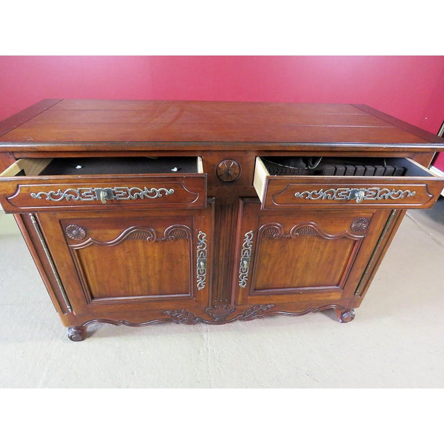 Drexel Heritage Continental style commode with 2 drawers over 2 doors containing 2 shelves.