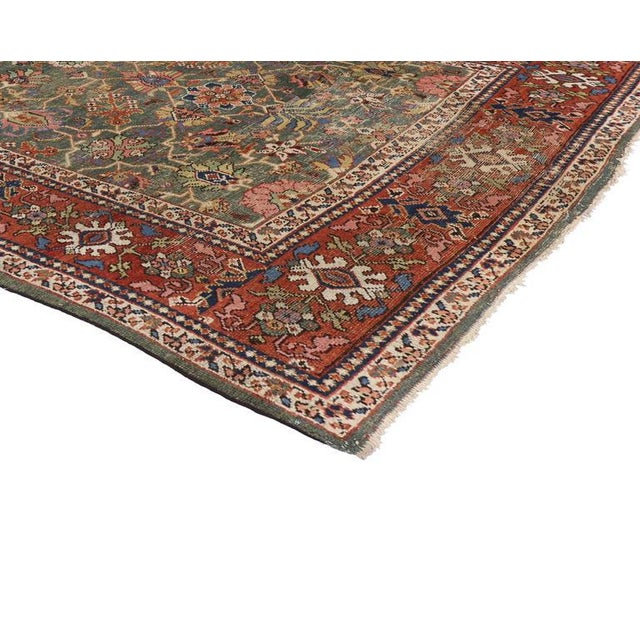 Full of character and stately presence, this antique Persian Sultanabad showcases an extravagant geometric design and...