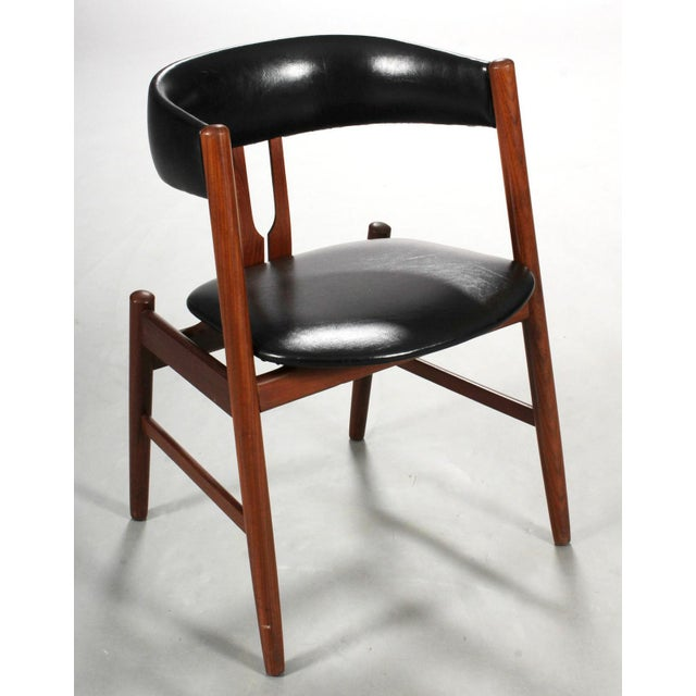 Armchair with solid teak frame, seat and headpiece upholstered. Designed in the early 1970s. In the style of Kai...