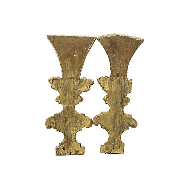 Pair of hand-carved wood wall-mounted corbels, circa 1800. Original paint and gilding. No maker's mark. Age wear, tip of...