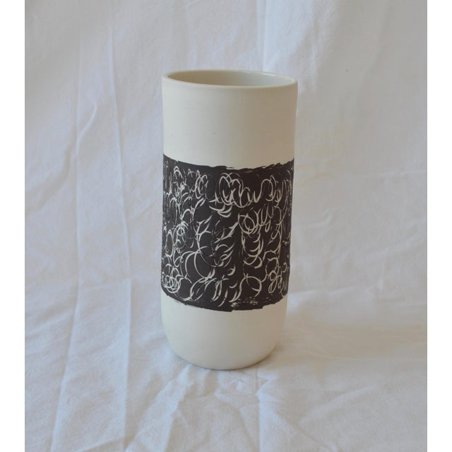 The scribble stripe is inspired by Cy Twombly's work, which I adore. The porcelain vessel is thrown and trimmed. An ebony...