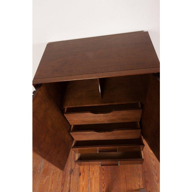 Mid-Century bureau by Lane Furniture of Alta Vista, Virginia. Having rosewood finished doors with chrome hardware which...