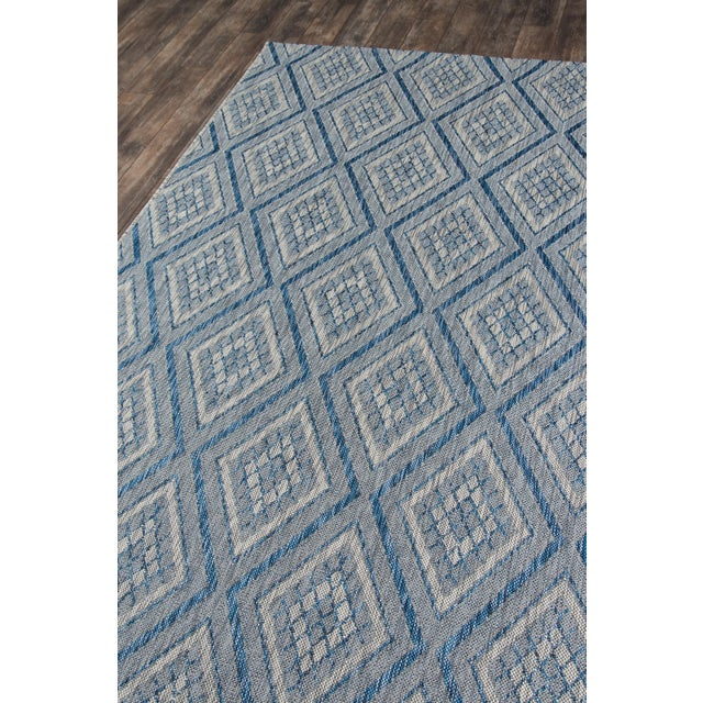 Weatherproof and wildly chic, this indoor/outdoor area rug is interior elegance outfitted for the backyard. The geometric...