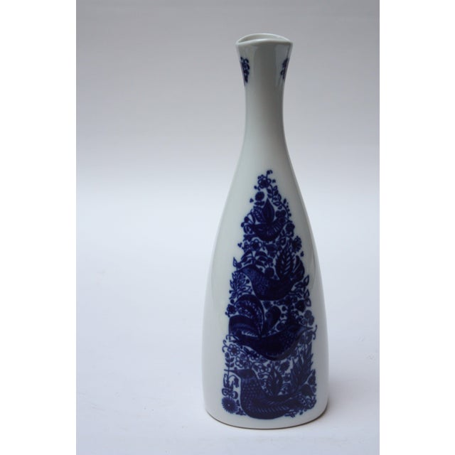 Tall, shapely vessel / vase manufactured by Porsgrund Norway. Intricate ink blue design with bird and floral motif on both...