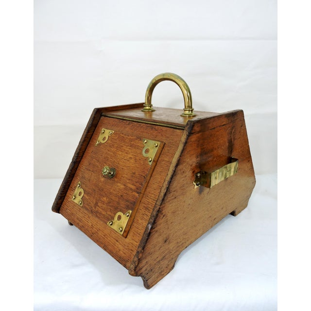 Late Victorian era oak coal scuttle or purdonium with brass carrying handle and attractive brass embellishments both on...