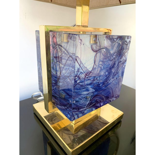 Very fresh pair of brass cage lamps with an impressive and massive color blue Murano pressed glass cube. Measures: Height...