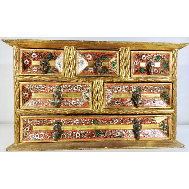 Outstanding gold gilt surrounds this chest with beautiful rope details. The front panels of the six drawers are decorated...