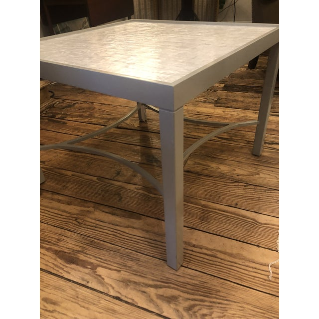 Sleek white and gray square cocktail table having recessed mosaic like faux mother of pearl or tessellated stone top and...