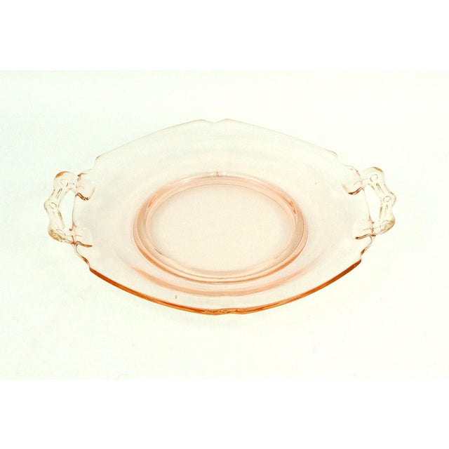 This set of pink Depression glass bowl and plate with handles, was very likely (not marked) made by Anchor Hocking glass...