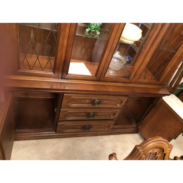 """This is a very large 2 piece china cabinet with lighting in it and 2 large glass shelves. It is approx 60"""" x 17"""" x 77"""",..."""